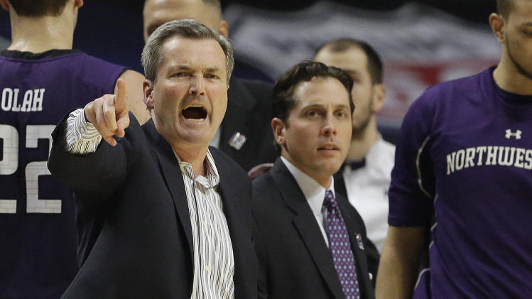 Northwestern head coach Bill Carmody reacts to a call during the first half of an NCAA college basketball game at the Big Ten tournament against Iowa Thursday, March 14, 2013, in Chicago. (AP Photo/Nam Y. Huh)
