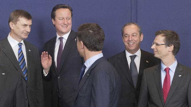 From left, Estonia's Prime Minister Andrus Ansip, British Prime Minister David Cameron, Dutch Prime Minister Mark Rutte, Malta's Prime Minister Lawrence Gonzi and Secretary General of the Council Uwe Crsepius during a group photo at a EU Budget summit at the European Council building in Brussels, Thursday, Feb. 7, 2013. European Union leaders drew hard lines Thursday ahead of a struggle over EU spending for the next seven years that reflects deep divisions about the role of their union. (AP Photo/Michel Euler)