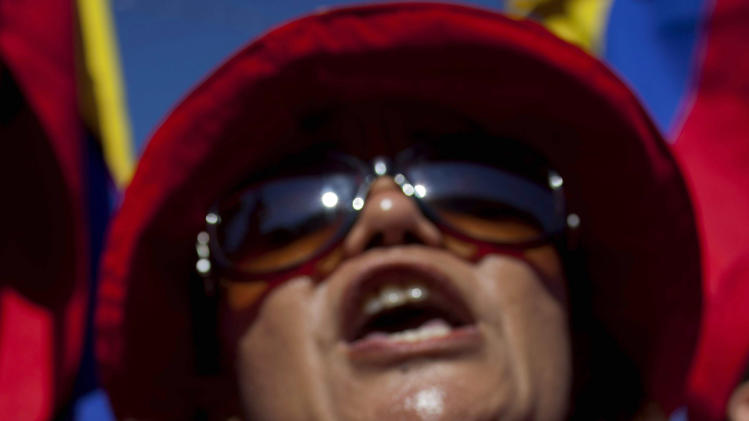 "A Venezuelan woman cheers during a demonstration in support of Venezuela's President Hugo Chavez in front of the embassy of Venezuela in Havana, Cuba, Sunday, Dec. 9, 2012.  Chavez is to return to Cuba Sunday for another surgery in his battle against cancer, which has led him to speak publicly of a successor for the first time.  Chavez said Saturday that if there are ""circumstances that prevent me from exercising the presidency further""  Vice-President Nicolas Maduro should replace him for the remainder of his term.(AP Photo/Ramon Espinosa)"