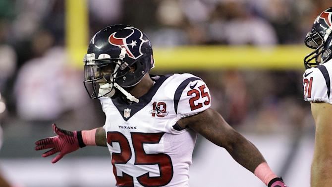 In this photo taken Oct. 8, 2012, Houston Texans defensive back Kareem Jackson reacts after making an interception late in the second half of an NFL football game against the New York Jets in East Rutherford, N.J. Jackson interception helped sealed the Texans 23-17 victory. (AP Photo/Kathy Willens)