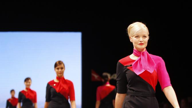 Qantas employees present the new company uniform during a fashion show in Sydney