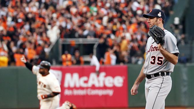 Detroit Tigers starting pitcher Justin Verlander waits for a new ball as San Francisco Giants' Pablo Sandoval rounds the bases after hitting a home run during the first inning of Game 1 of baseball's World Series Wednesday, Oct. 24, 2012, in San Francisco. (AP Photo/Ezra Shaw, Pool)