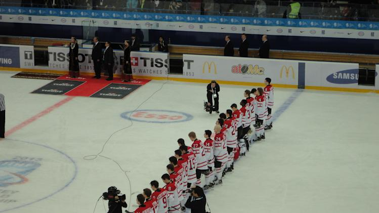 Team Canada lined up on the blue line in Ufa, Russia at WJHC 2013 (Sunaya Sapurji)