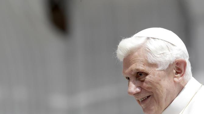 Pope Benedict XVI waves as he arrives for an audience to followers of the Renewal In Spirit movement in St. Peter's square at the Vatican, Saturday, May 26, 2012. The Vatican has confirmed Saturday, May 26, 2012, that the pope's butler Paolo Gabriele was arrested in an embarrassing leaks scandal. Spokesman the Rev. Federico Lombardi said Paolo Gabriele was arrested in his home inside Vatican City with secret documents in his possession. Gabriele, a layman, was being held. Vatican documents leaked to the press in recent months have pointed to power struggles and accusations of corruption touching senior Vatican cardinals.(AP Photo/Riccardo De Luca)