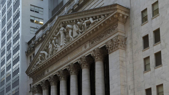 Early morning commuters pass the New York Stock Exchange Thursday, Dec. 20, 2012. Shares in the company that runs the New York Stock Exchange are surging amid reports that it is in talks to sell itself to a rival stock exchange, Atlanta-based Intercontinental Exchange Inc. (AP Photo/Richard Drew)