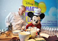 Mickey Mouse is seen at a display for healthy food during a press conference to announce changes to Disney's nutrition guideline policy at the Newseum in Washington