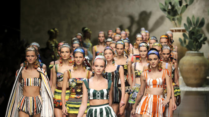 Models wear creations part of the Dolce & Gabbana women's Spring-Summer 2013 fashion collection, during the fashion week in Milan, Italy, Sunday, Sept. 23, 2012. (AP Photo/Antonio Calanni)