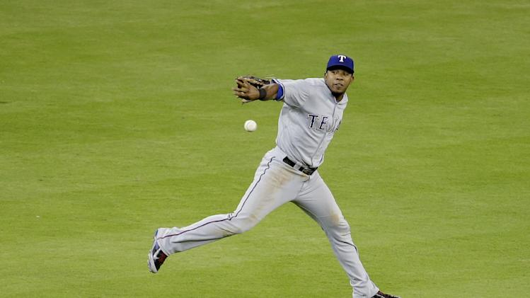 Texas Rangers shortstop Elvis Andrus fields the ball during a baseball game against the Miami Marlins, Tuesday, Aug. 19, 2014, in Miami. The Marlins defeated the Rangers 4-3 in ten innings. (AP Photo/Lynne Sladky)