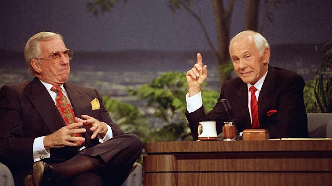 """FILE - In this May 22, 1992, file photo, talk show host Johnny Carson, right, appears with the show's announcer Ed McMahon during the final taping of the """"Tonight Show"""" in Burbank, Calif. Content from """"The Tonight Show Starring Johnny Carson"""" is available for digital download. Starting Tuesday, July 23, 2013, two volumes of material from the King of Late Night can be purchased from the iTunes store. (AP Photo/Douglas C. Pizac, File)"""
