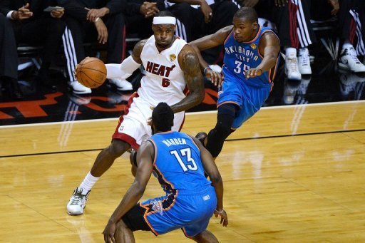 Miami Heat's eBron James (L) made 11-of-23 shots from the field and was a force on both defense and offense