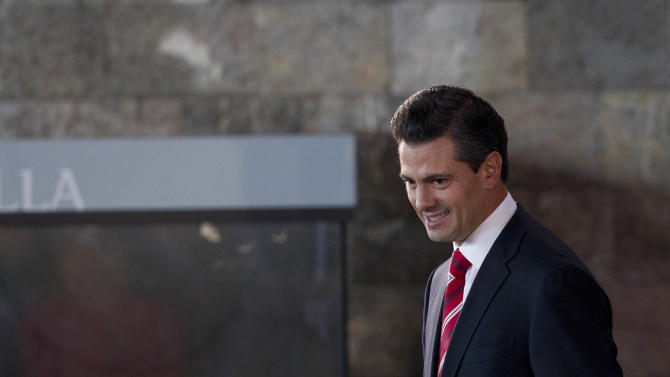 Mexico's President Enrique Pena Nieto leaves after attending an event to announce an education reform proposal in Mexico City, Monday, Dec. 10, 2012. Pena Nieto is proposing sweeping reforms to the public education system widely seen as moribund, taking on Elba Esther Gordillo, an iron-fisted union leader who is considered the country's most powerful woman and the main obstacle to change. (AP Photo/Alexandre Meneghini)