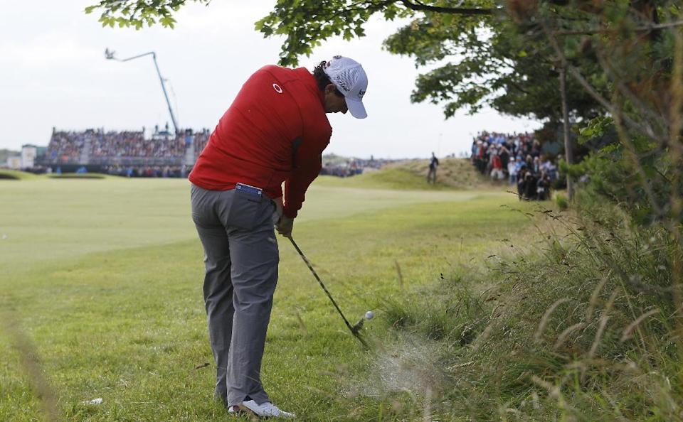 Rory McIlroy of Northern Ireland plays out of the rough on the second fairway at Royal Lytham & St Annes golf club during the second round of the British Open Golf Championship, Lytham St Annes, England, Friday, July 20, 2012. (AP Photo/Tim Hales)