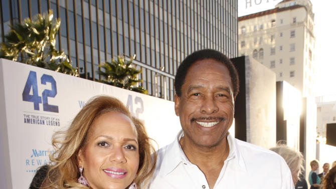 "Former Major League Baseball player Dave Winfield poses with his wife Tonya Turner at the LA premiere of ""42"" at the TCL Chinese Theater on Tuesday, April 9, 2013 in Los Angeles. (Photo by Todd Williamson /Invision/AP)"