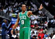 Rajon Rondo of the Boston Celtics directs his team against the Atlanta Hawks in Game One of the Eastern Conference Quarterfinals in the 2012 NBA Playoffs on April 29, at Philips Arena in Atlanta, Georgia. Rondo was suspended by the NBA for one game on Monday after bumping into a referee during a playoff game on Sunday