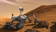 In this 2011 artist's rendering provided by NASA/JPL-Caltech, the Mars Science Laboratory Curiosity rover examines a rock on Mars with a set of tools at the end of its arm, which extends about 2 meters (7 feet). The mobile robot is designed to investigate Mars' past or present ability to sustain microbial life. (AP Photo/NASA/JPL-Caltech)