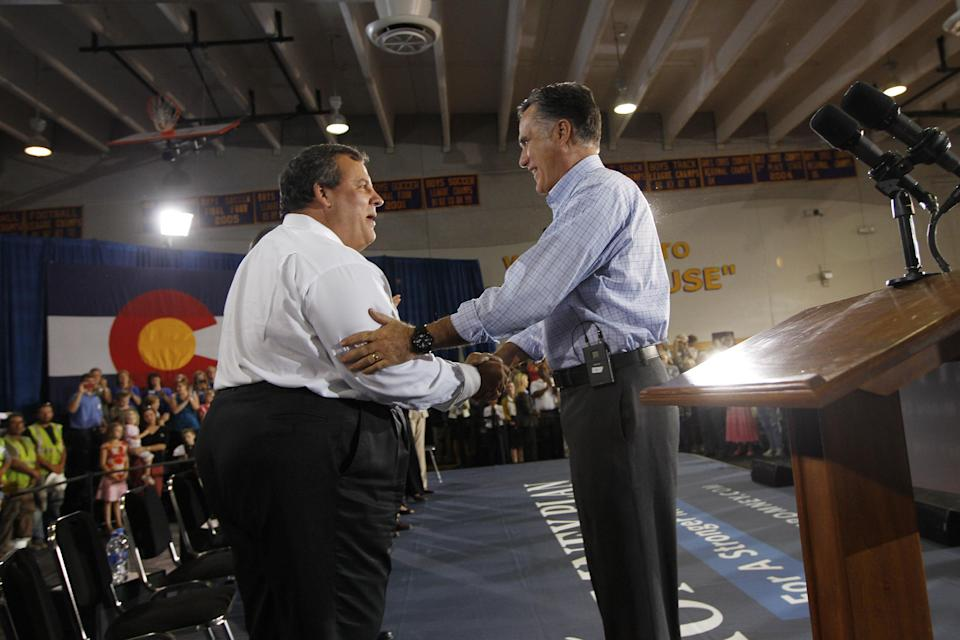 Republican presidential candidate and former Massachusetts Gov. Mitt Romney greets New Jersey Gov. Chris Christie as he campaigns at Basalt Public High School, in Basalt, Colo., Thursday, Aug. 2, 2012, en route to Aspen, Colo. (AP Photo/Charles Dharapak)