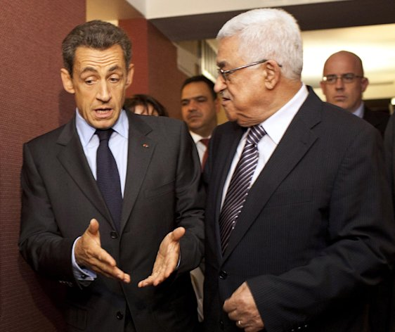 French President Nicolas Sarkozy, left, meets with Palestinian President Mahmoud Abbas at the Millennium Hotel on 44th Street during the 66th session of the General Assembly in New York on Tuesday, Sept. 20, 2011. (AP Photo/Andrew Burton)