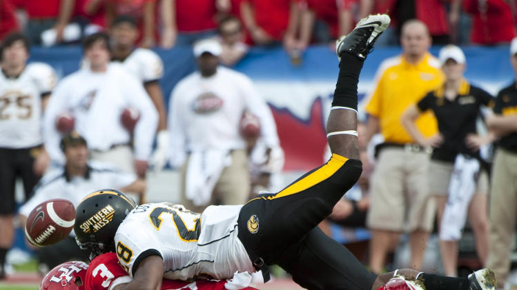 Southern Mississippi's Jacorius Cotton (28) breaks up a pass intended for Houston's Justin Johnson (3) during the first quarter of a Conference USA championship NCAA college football game, Saturday, Dec. 3, 2011, in Houston. Southern Mississippi beat Houston 49-28. (AP Photo/Dave Einsel)