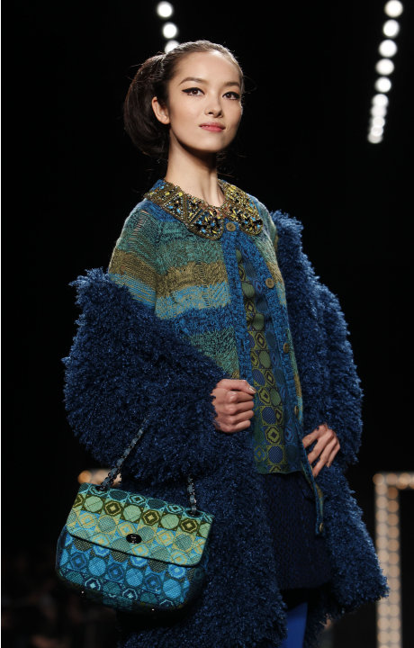 The Anna Sui Fall 2013 collection is modeled during Fashion Week, Wednesday, Feb. 13, 2013 in New York. (AP Photo/Jason DeCrow)