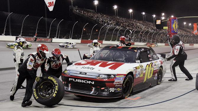 Greg Biffle's pit crew works on his car during the NASCAR Sprint Cup Series auto race at Darlington Raceway, Saturday, May 12, 2012, in Darlington, S.C. (AP Photo/Mary Ann Chastain)