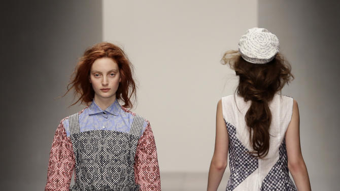 A model presents a creation by Kinder Aggugini during his Spring/Summer 2013 show at London Fashion Week in London, Saturday, Sept. 15, 2012. (AP Photo/Alastair Grant)