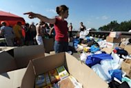 <p>Russians pack boxes of donated clothing, food and household items at a humanitarian aid collection point in Moscow. Pro-government and opposition newspapers have showed rare unanimity in saying the authorities badly failed local inhabitants in the worst-hit town of Krymsk.</p>