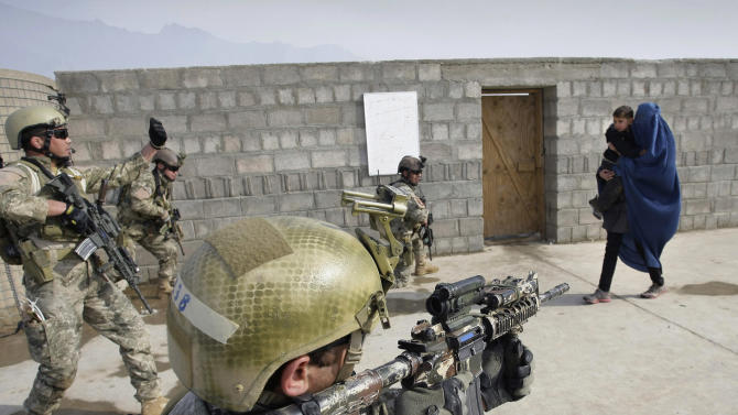 FILE - In this Monday, Jan. 14, 2013 file photo members of Afghan special forces conduct a training exercise using actors on the outskirts of Kabul, Afghanistan. A senior U.S. commander said Saturday, March 30, 2013 that American special operations forces have handed over their base in eastern Afghanistan's Nirkh district to local Afghan commandos -- meeting a demand by Afghan President Hamid Karzai that U.S. forces withdraw from the district after allegations that their Afghan counterparts committed human rights abuses there. (AP Photo/Musadeq Sadeq, File)