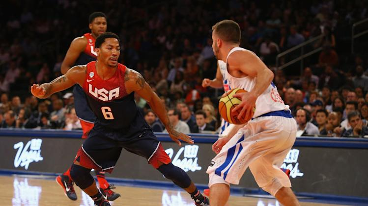 Derrick Rose (No. 6) of the USA defends against Jose Barea of Puerto Rico during their game at Madison Square Garden in New York, on August 22, 2014