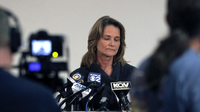 Barbara Baker, CEO and president of the Pittsburgh Zoo and PPG Aquarium pauses as she answers questions during a news conference on Monday, Nov. 5, 2012, in Pittsburgh. Zoo officials said a young boy was killed after he fell into an African wild dog exhibit and the dogs mauled him on Sunday, Nov. 4, 2012. (AP Photo/Keith Srakocic)