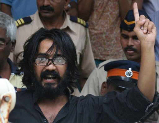 Indian cartoonist Aseem Trivedi gestures outside a court in Mumbai on September 9. A court in Mumbai granted bail on Tuesday to the cartoonist, whose arrest on sedition charges over his work lampooning the government has triggered outrage, media reports said.