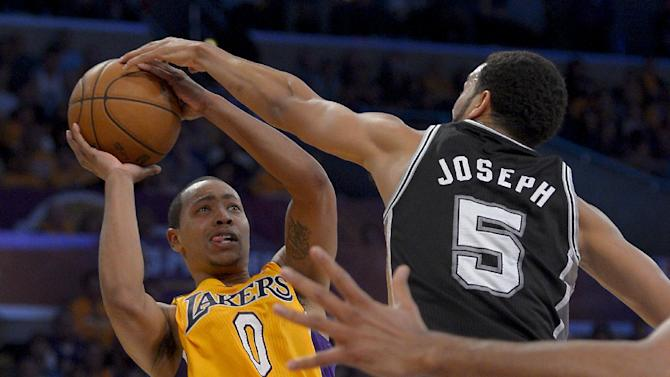 San Antonio Spurs guard Cory Joseph, right, blocks a shot by Los Angeles Lakers guard Andrew Goudelock during the second half in Game 3 of a first-round NBA basketball playoff series, Friday, April 26, 2013, in Los Angeles. (AP Photo/Mark J. Terrill)