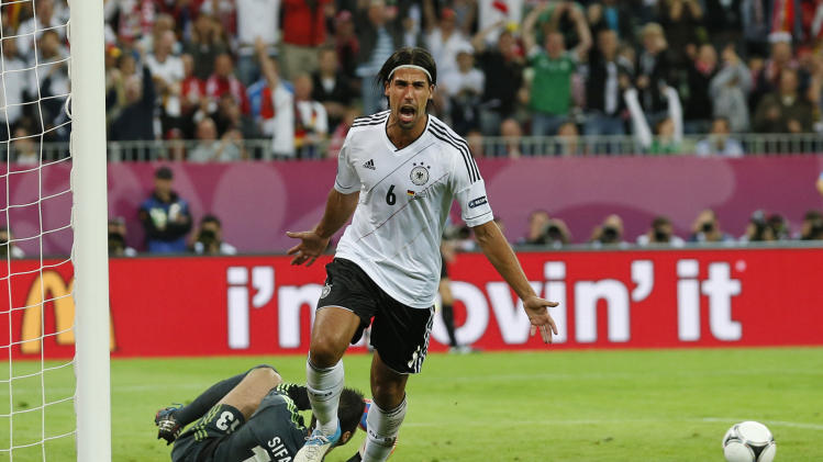 Germany's Sami Khedira celebrates after he scored his team's second goal by Greece goalkeeper Michalis Sifakis during the Euro 2012 soccer championship quarterfinal match between Germany and Greece in Gdansk, Poland, Friday, June 22, 2012. (AP Photo/Jon Super)