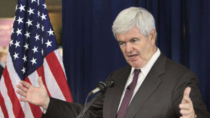 FILE - Republican presidential hopeful, former House Speaker Newt Gingrich gestures while speaking during a Town Hall style meeting at the Derry Medical Center  in Derry, N.H., in this May 25, 2011 file photo. The entire top echelon of Newt Gingrich's presidential campaign resigned on Thursday, June 9, 2011 a stunning mass exodus that left his bid for the Republican nomination in tatters. But the former House speaker vowed defiantly to remain a candidate. (AP Photo/Jim Cole)