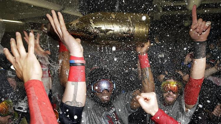 Boston Red Sox's David Ortiz celebrates with teammates after Game 6 of baseball's World Series against the St. Louis Cardinals Thursday, Oct. 31, 2013, in Boston. The Red Sox won 6-1 to win the series. Ortiz was names the series MVP