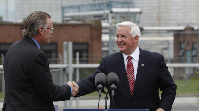 Pennsylvania Gov. Tom Corbett, right, greets President of Delta Air Lines Inc. Ed Bastian during a news conference in front of a ConocoPhillips refinery, Tuesday, May 1, 2012, in Trainer, Pa. Delta Air Lines Inc. Monday, said it will buy the refinery as part of an unprecedented deal that it hopes will cut its jet fuel bill. (AP Photo/Matt Rourke)