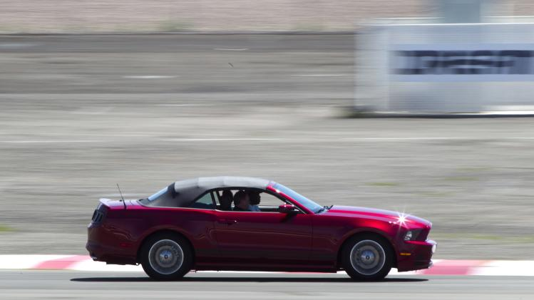 A late-model Mustang convertible drives on an infield course during the Mustang 50th Birthday Celebration at the Las Vegas Motor Speedway in Las Vegas