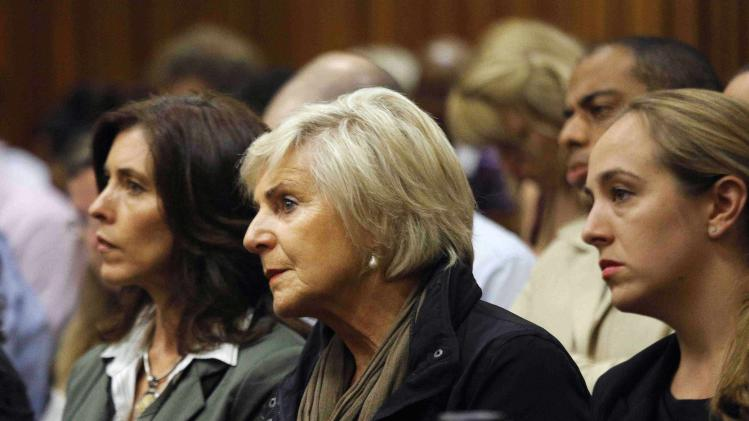 Family members of Olympic and Paralympic track star Oscar Pistorius listen during proceedings at the North Gauteng High Court in Pretoria
