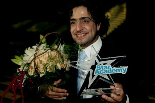 "Saudi Arabia's Abdul Aziz Abdul Hamid wins the first award of the Star Academy, a pan-Arab television show produced by Lebanese Broadcasting Corporation, in Beirut in 2009. A Saudi city known for its ultra-conservatism has created its own version of the ""Arabs Got Talent"" television reality show, but with no music and women banned from taking part"