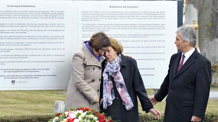 "Interior Minister Johanna Mikl-Leitner, Resistance fighter Katharina Sasso and Austrian Chancellor Werner Faymann, from left, attend the unveiling of a plaque honoring the thousands of Austrians killed by the Nazis for opposing them, before and after the so-called ""Anschluss"" at the Central Cemetary in Vienna, Austria, Monday, March 11, 2013. Austria's chancellor has urged fellow Austrians to strive to prevent a return of the political climate that allowed Nazi atrocities, in comments marking Germany's annexation of Austria 75 years ago. (AP Photo/Hans Punz)"