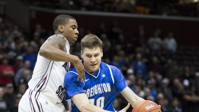 Creighton guard Grant Gibbs (10) drives past Missouri State forward Keith Pickens (1) during the first half of an NCAA college basketball game Friday, Jan. 11, 2013, in Springfield, Mo (AP Photo/David Welker)