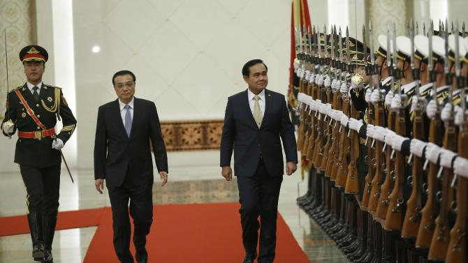 Thailand's Prime Minister Prayuth and China's Premier Li inspect honour guards during a welcoming ceremony inside the Great Hall of the People in Beijing