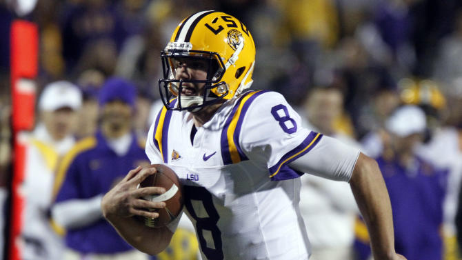 LSU quarterback Zach Mettenberger (8) runs against Mississippi during the fourth quarter of an NCAA college football game in Oxford, Miss., Saturday, Nov. 19,  2011. LSU won 52-3. (AP Photo/Rogelio V. Solis)