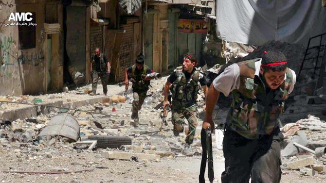 This Tuesday, July 9, 2013 citizen journalism image provided by Aleppo Media Center AMC, which has been authenticated based on its contents and other AP reporting, shows Syrian rebels running during heavy clashes with Syrian soldiers loyal to Syrian President Bashar Assad, in the Salah al-Din neighborhood of Aleppo, Syria. Syria is entering its third year of a war that began as an uprising against the rule of President Bashar Assad. (AP Photo/Aleppo Media Center AMC)