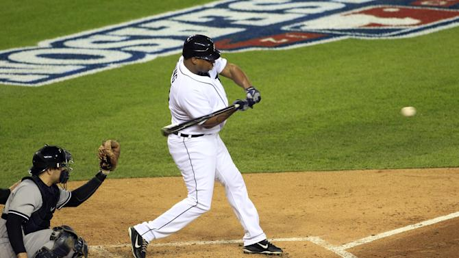 Detroit Tigers' Delmon Young hits a home run in the fourth inning during Game 3 of the American League championship series against the New York Yankees Tuesday, Oct. 16, 2012, in Detroit. New York Yankees catcher Russell Martin is at left. (AP Photo/Carlos Osorio)