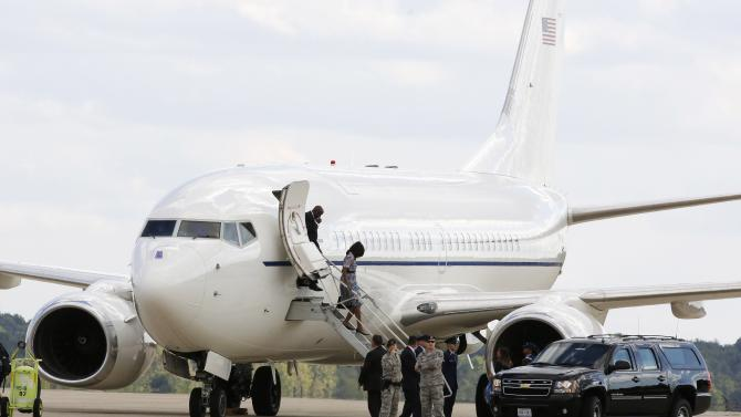 First lady Michelle Obama steps off an aircraft at Andrews Air Force Base outside Washington