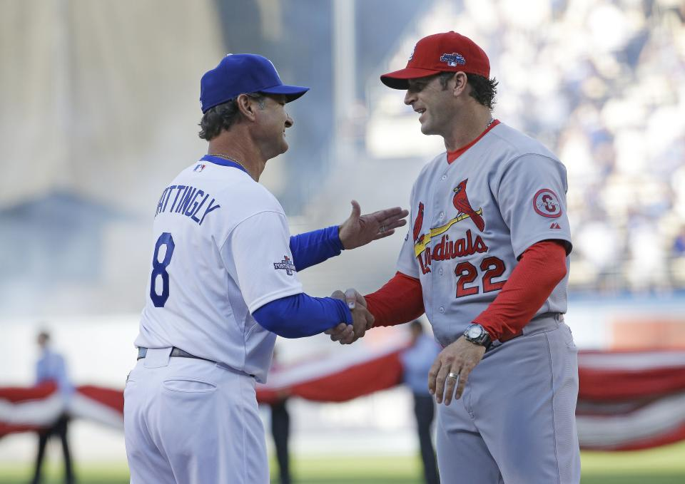 St. Louis Cardinals' Mike Matheny shakes hands with Los Angeles Dodgers manager Don Mattingly before Game 3 of the National League baseball championship series Monday, Oct. 14, 2013, in Los Angeles. (AP Photo/David J. Phillip)