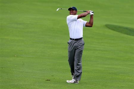 Tiger Woods plays from the fairway on the 17th hole during the fourth round of the Presidents Cup at Muirfield Village Golf Club. Brian Spurlock-USA TODAY Sports