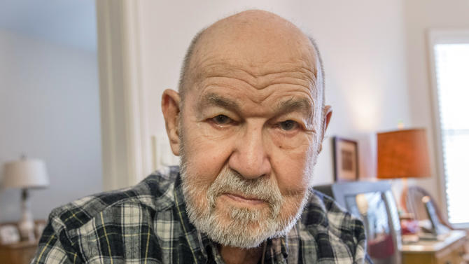 """In this Thursday, Jan. 10, 2013 photo, retired Col. Dan """"Dante"""" Bulli poses for a photo at his home in Omaha, Neb. Bulli was the pilot of a B-52 that crashed on a mountainside in Maine 50 years ago. He was one of two who survived the crash. (AP Photo/Nati Harnik)"""
