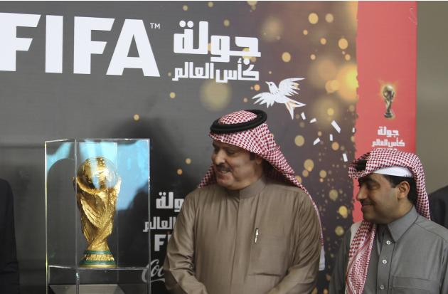 Saudi soccer league official Nouiser looks at the soccer World Cup trophy at King Khalid International Airport in Riyadh