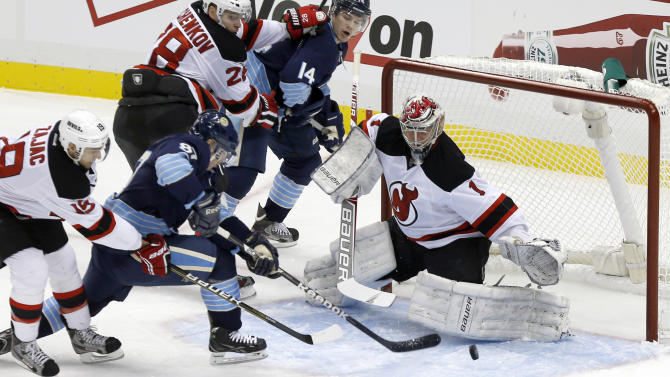 New Jersey Devils goalie Johan Hedberg (1) makes a save on Pittsburgh Penguins' Sidney Crosby (87) in the first period of an NHL hockey game on Sunday, Feb. 10, 2013, in Pittsburgh. (AP Photo/Keith Srakocic)